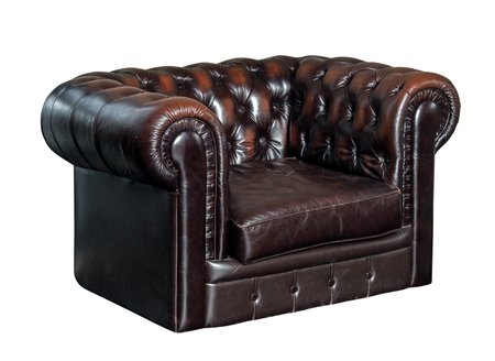 antique furniture: Classic brown leather armchair isolated Stock Photo