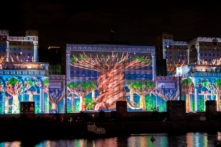 International Festival Circle of Light. Laser video mapping show on facade of the Ministry of Defense in Moscow, Russia