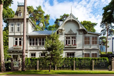 Typical wooden latvian houses, traditional Jurmala architecture Stock Photo