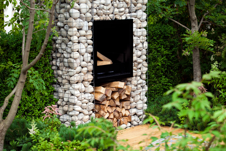 Street fireplace with woods in garden design landscape