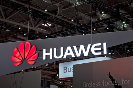 Hannover, Germany - March, 2017: Huawei company logo on the wall. Huawei Technologies Co. is a Chinese multinational networking and telecommunications equipment and services company