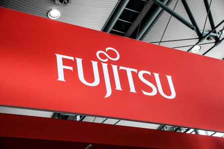 Hannover, Germany - March, 2017: Fujitsu company logo sign on exhibition fair Cebit 2017 in Hannover Messe, Germany
