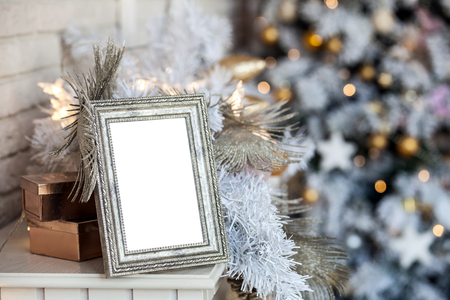 White photo frame with christmas background Stock Photo