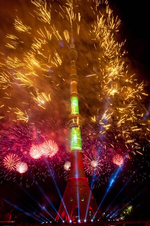 International Festival Circle of Light. Laser video mapping show on Ostankino TV tower in Moscow, Russia. 3D projection mapping on building and firework show