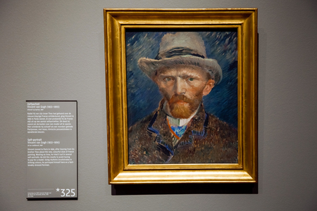 Canvas with self-portrait artwork of famous painter Vincent van Gogh. Close up painting in Rijsmuseum in Amsterdam city, Holland Editorial