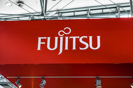 Fujitsu company logo sign on exhibition fair Cebit 2017 in Hannover Messe, Germany