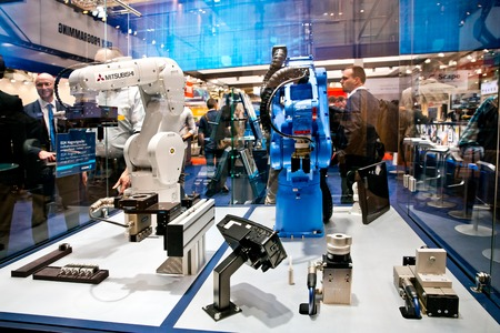 Mitsubishi and Yaskawa robot arms on Schunk stand on Messe fair in Hannover, Germany Editöryel
