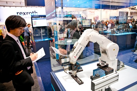Mitsubishi robot arm on Schunk stand on Messe fair in Hannover, Germany