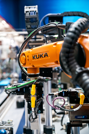 Kuka robot on Schunk assembly electronics line on Messe fair in Hannover, Germany