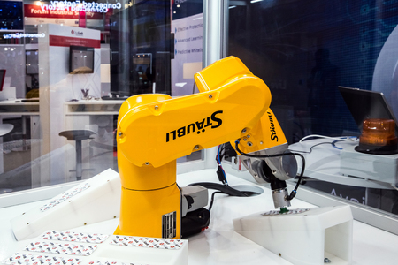 Automatic Staubli Industrial Robot on Messe fair in Hannover, Germany