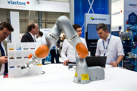 Kuka industrial robot with grippers on Messe fair in Hannover, Germany