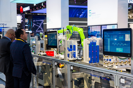 Industrial assembly line with robots powerded by COSMOPlat on Messe fair in Hannover, Germany Editöryel