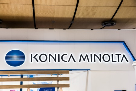 Konica Minolta logo sign on booth stand on Messe fair in Hannover, Germany
