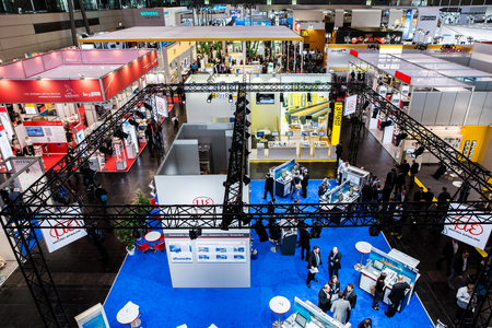Visitors in exhibition stands and booths on Messe fair in Hannover, Germany