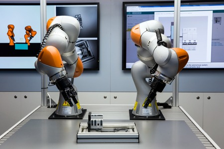 Future of automation, autonomous system with Kuka robots on Siemens stand on Messe fair in Hannover, Germany
