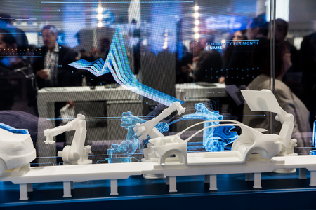 Simulating of car manufacturing by robots on Siemens stand on Messe fair in Hannover, Germany Editöryel
