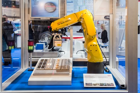 Automatic Industrial Robot Fanuc LR Mate 200 iD and laser scanner with integrated controller for 2D/3D scans on Messe fair in Hannover, Germany