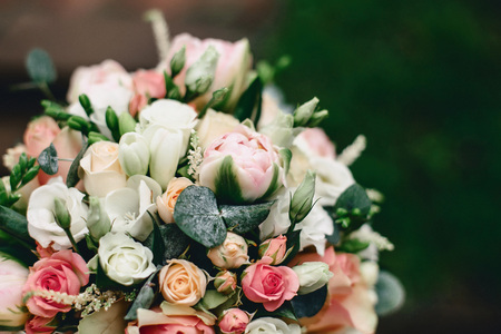 wedding bouquet for bride from roses and other great flowers on the green background