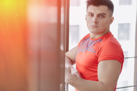 young guy at the window, healthy lifestyle