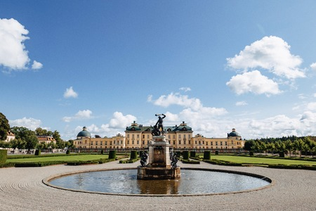 Stockholm Palace or the Royal Palace, panorama view from the fountain at park, Sweden