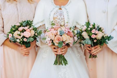 the bride holds a wedding bouquet in her hands, wedding day flowers Stock Photo