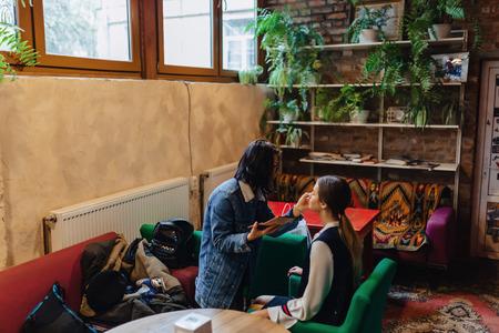 girl doing make up in cafe indoor