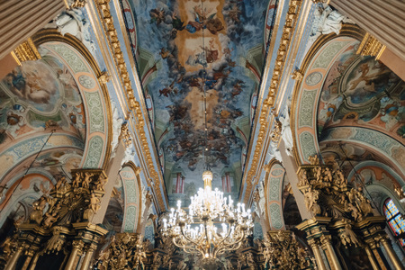 Ternopil, Ukraine - 20 October 2018: Cathedral of the Immaculate Conception of the Blessed Virgin Mary, ceiling and chandelier, editorial