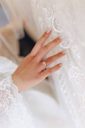 engagement ring with a stone on the gentle bride's hand, wedding tenderness