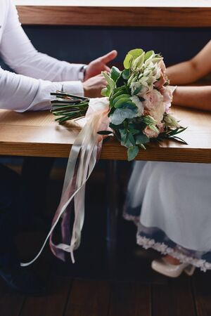 the bride holds a wedding bouquet in her hands, wedding day flowers 写真素材