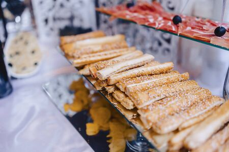 festive salty buffet, fish, meat, chips, cheese balls and other specialties for celebrating weddings and other events well decorated