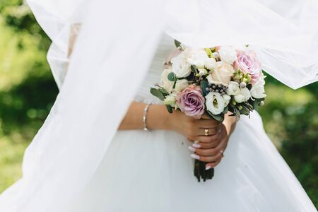 the bride holds a wedding bouquet in her hands, wedding day flowers Stock fotó