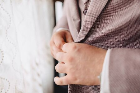 groom morning meeting, details, jacket, shoes, watches and buttons on the wedding day