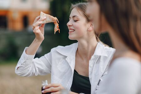 appetizing attractive girl eating pizza