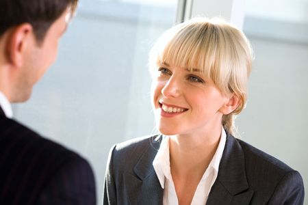 Portrait of young smiling  woman gazing at business man Stock Photo - 2425010
