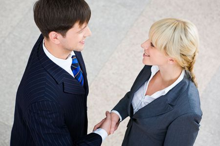 Handshake of confident business people looking at each other Stock Photo - 2432338
