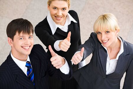 Success in business: several business people showing a sign of okay Stock Photo - 2432333