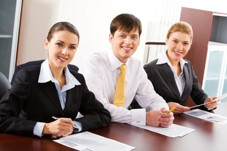 Image of three business people sitting at the table in a line  Stock Photo - 2432335