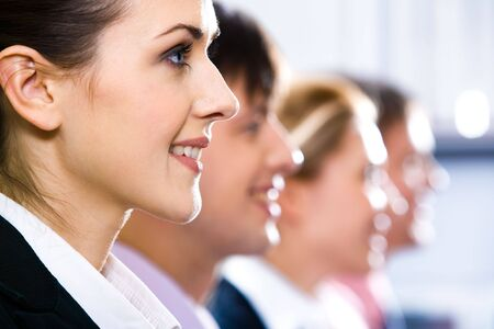 Line of half faces of young smiling specialists Stock Photo - 2432323