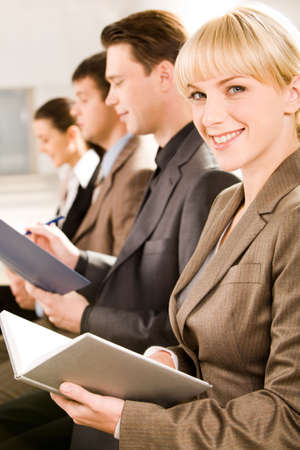 glancing: Image of business woman glancing at camera during a seminar