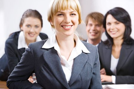 Portrait of smiling female leader on the background of  her business team Stock Photo - 2432403