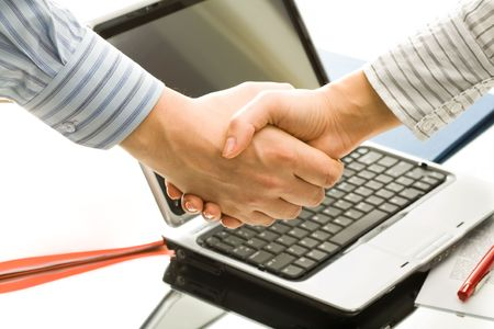 deal in: Successful handshake to seal a business deal in an office  Stock Photo