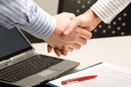 autograph: Image of business people shaking hands in a working environment