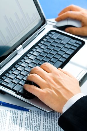 Typical image of hands typing on a laptop photo