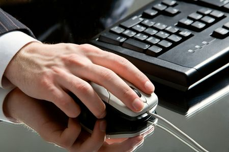 Image of male hand pressing the buttons of computer mouse Stock Photo - 2430190