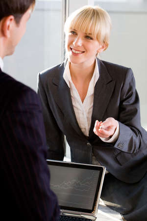 Portrait of business partner talking to her colleague in the office Stock Photo - 2432344