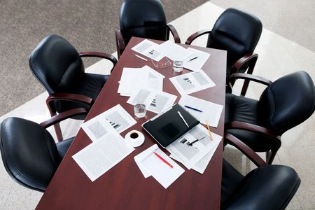 Image of large table and six black chairs in the boardroom Stock Photo