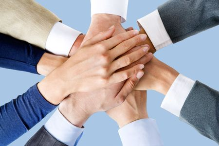 each: Photo of business people's hands on top of each other  Stock Photo