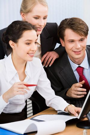 Group of three business people working together photo