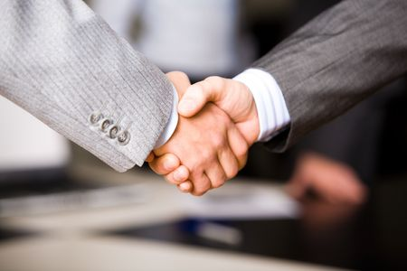 Successful handshake of business men in a working environment Stock Photo - 2430196