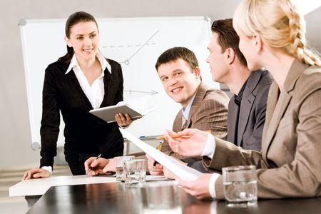 new strategy: Portrait of business people discussing a new strategy at a seminar